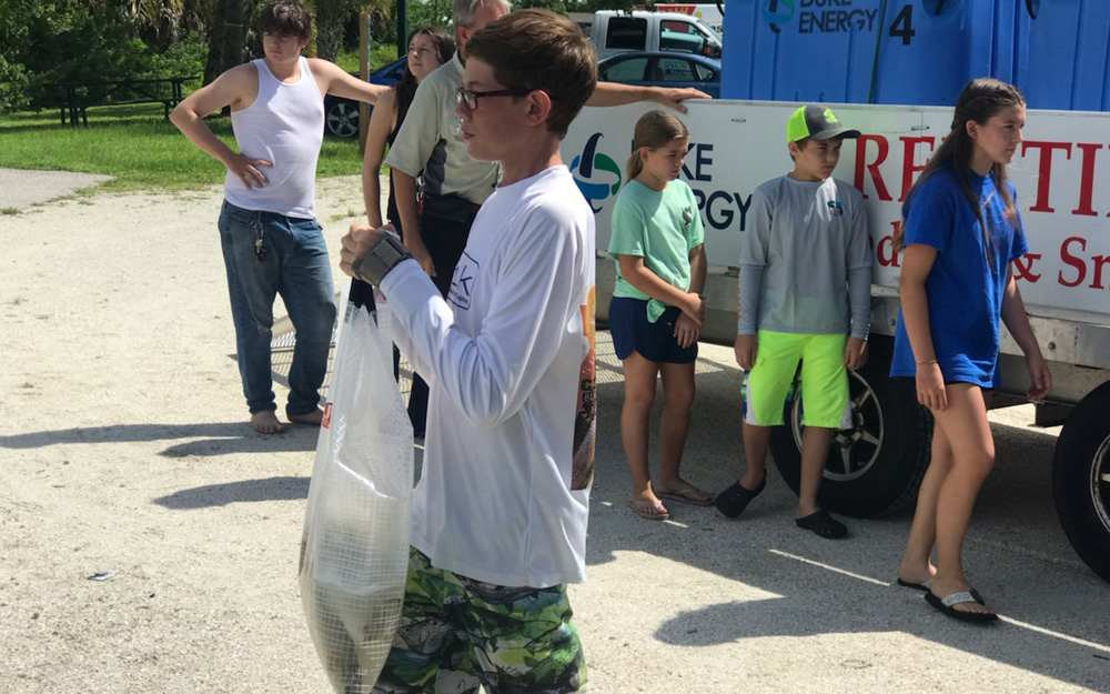 Mike Brimers Son Carrying Redfish to Port Charlotte Waters